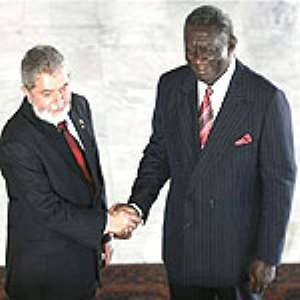 President Kufuor (right) in a handshake with the Brazilian President
