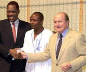 Abedi Pele, FIFA President Blatter & Issa Hayatou - President of African Soccer Federation (AFP)