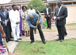 Prez cuts sod for start of work  at Assemblies of God church