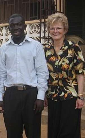 George Sarfo in pose with the Chair of Entrepreneur at the Seattle University Professor Harriet Stephenson