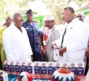 Vice  President Mahama inspecting some of the Chibuku drink with Dr Charles Mensah (R), Board Chairman of Accra Brewery