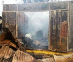 One of the burnt container shops with its smothering content