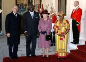 Britain's Queen Elizabeth (2nd R) and the Duke of Edinburgh (L) meet Ghana's President John Agyekum Kufuor and his wife Theresa at Buckingham Palace in London