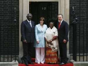 Britain's Prime Minister Tony Blair (R) and his wife Cherie (2nd L) pose with Republic of Ghana President John Agyekum Kufuor (L) and his wife Theresa (2nd R) outside 10 Downing Street in London March 14, 2007