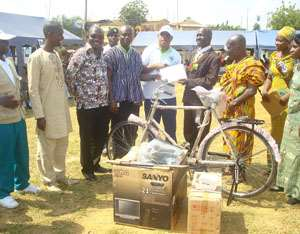 Shama District Best Farmer receives his prize