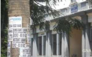 Loan Companies Deface Ministries With Posters