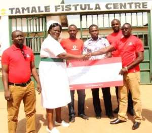 Some Vodafone Employees Presenting The Cheque To The Centre