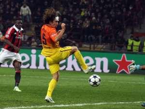 Sulley Muntari in action for Milan against Barcelona