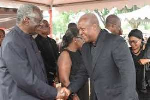 President John Dramani Mahama in a hand shake with Former president Kufour