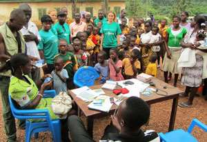 Beneficiary children and volunteers during the registration exercise