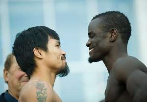 Manny Pacquiao and Joshua Clottey during the weighing