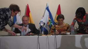 Hannah Tetteh and Avigdor Liberman signing the MOUs