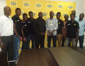 Officials of MTN, OMP and the finalist in a pose after the visit