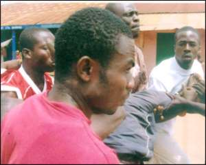 Kwame Nyame being carried for treatment