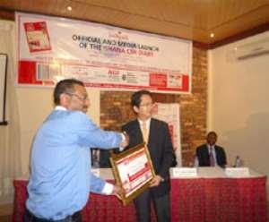Mr. Pallav Rastogi (Marketing Manager - Somotex Ghana Ltd) receiving the certificate from Mr. Jiro Inamura Chief Rep JICA Ghana