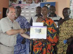 Gary Visser of Golden Star (Left) making a presentation to representatives of the beneficiary communities