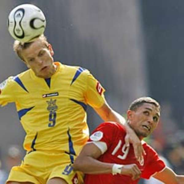 Ukraine's Oleg Gusev beats Tunisia's Anis Ayari in the air