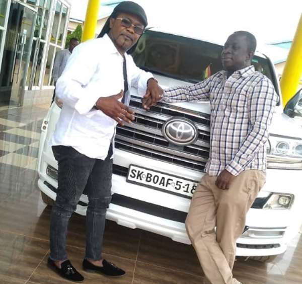 Nana Acheampong (left) in a pose with Dr. S.K Boafo