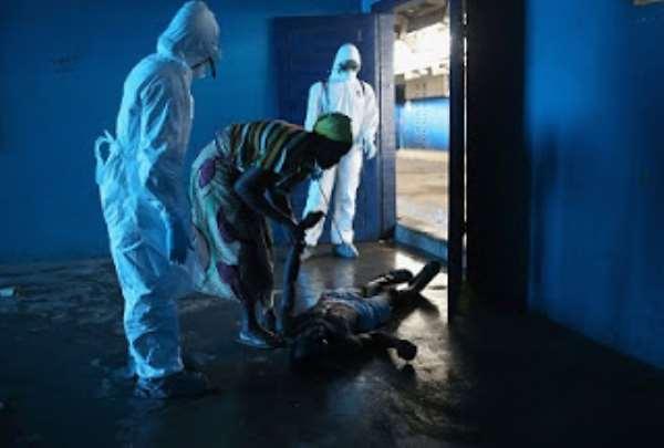 An Ebola victim lies on the floor