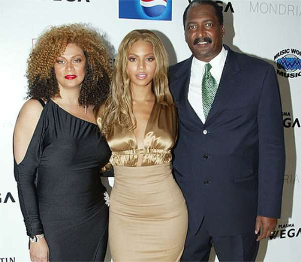 Beyonce with her mom and dad