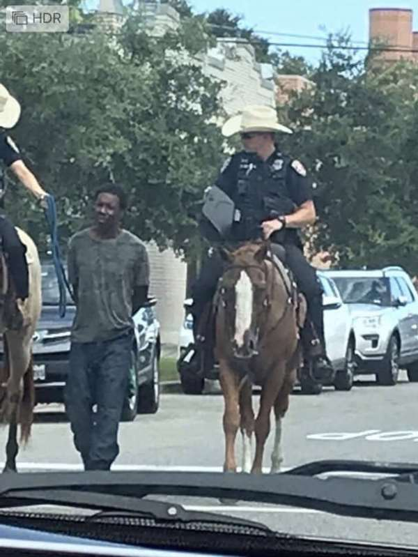 Black man with rope by the Texas Police