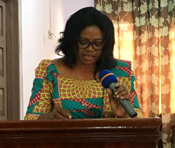 Mrs. Victoria Adu addressing the house