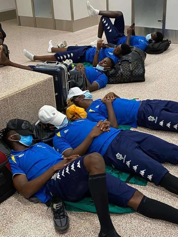 Gabon teammates sleeping on the floor at the Gambia airport