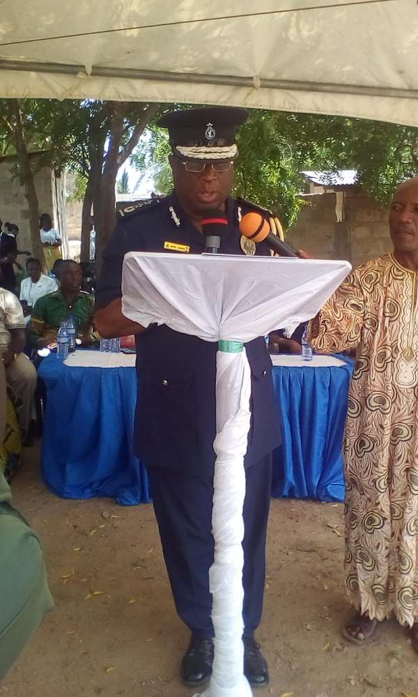 COP Rev.  Neenyi Ampah-Bennin (Below) And The Newly Built Police Station (Above)