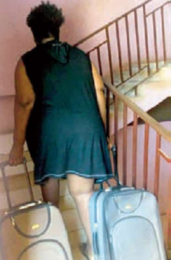 A student returning to the hall with her luggage