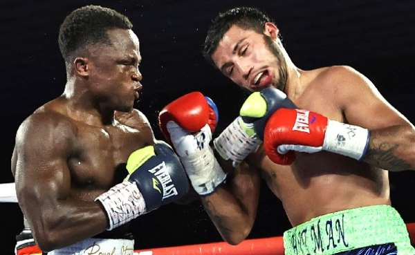Isaac Dogboe (left) knocked out Chris Avalos in eight rounds