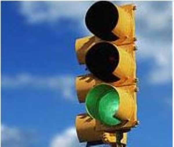 Driver fined  for picking passengers at a traffic light
