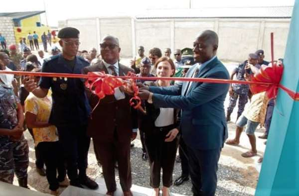 The Commissioner of the Customs Division of the GRA, Colonel Kwadwo Damoah (retd) (left), Mrs Briget La Cour Madsen (2nd right), and Mr Isaac Crentsil of the Ministry of Finance (2nd left), cutting the tape to inaugurate the dog training complex.