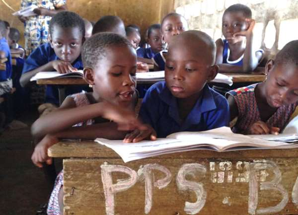 Children reading in school - Source: Wikimedia Commons