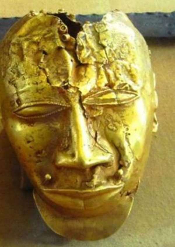 Gold mask, 20 cm in height, weighing 1.36 kg of pure gold, seized by the British from Kumasi, Ghana, in 1874 and now in the Wallace Collection, London, United Kingdom.