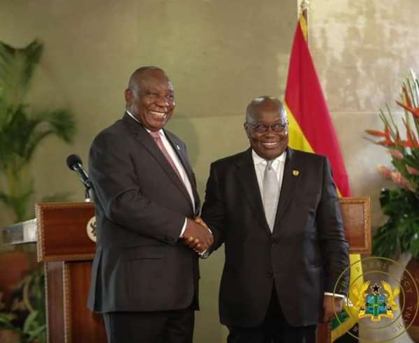 The two Presidents in a handshake after the signing ceremony