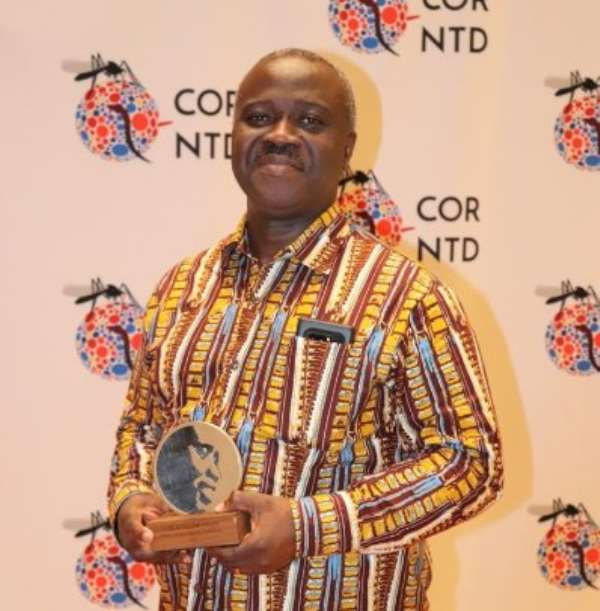 Professor John Owusu Gyapong with his award