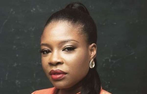 Video director, kemi Adetiba Torment Hearts with her Unbuttoned Shirt