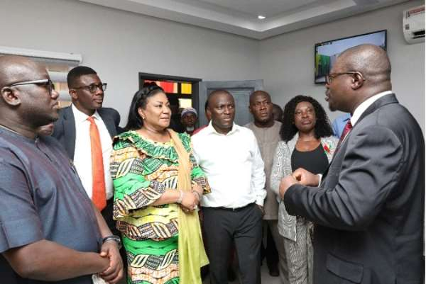 Dr. Patric Amo-Mensah (right), Medical Director of the hospital, speaking with the First Lady during a tour of the facility.