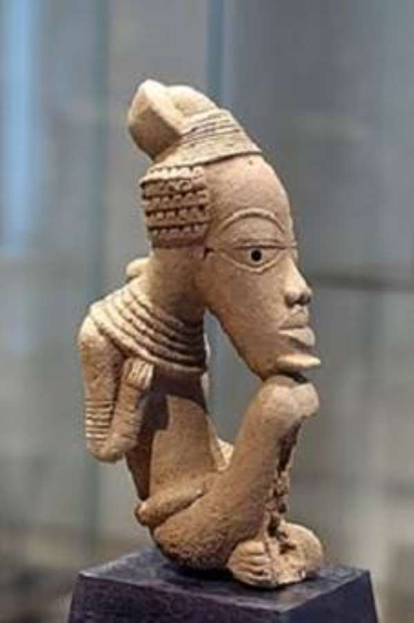 Figure of a seated male. One of the looted Nigerian Nok terracotta, now in the possession of the Musée du Quai Branly, in the Palais des Sessions, Paris, France, with post factum Nigerian consent even though the ICOM Red List For Africa forbids exportation of such artefacts.