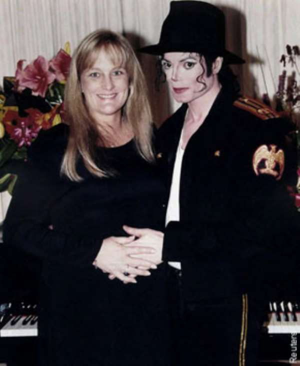 NOW $CRAM! Jacko s mom, Katherine allegedly agreed to pay his ex Debbie Rowe to avert a potential battle over their two kids.