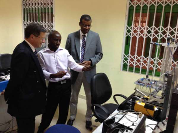 The VC of UMAT, Prof Jerry Kuma, and a teacher of the Faculty of Engineering, showing the Engineering laboratory to the French Ambassador