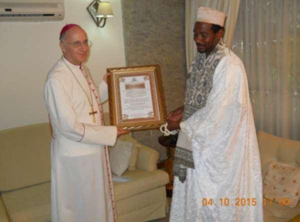 His Excellency Jean Malie Speich the Ambassador of Vatican Embassy in Ghana receiving citation from the Spiritual Leader of Tijaniyya Muslim Council of Ghana Sheikh Abul- Faidi Abdulai Ahmed Maikano.