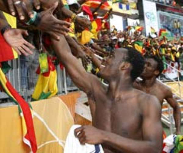 Ghana's Michael Essien is congratulated by fans after their victory over the USA