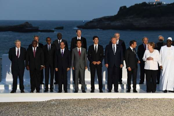 In happier and less challenging times: world leaders and guests pose for a picture on the second day of the annual G7 summit in Biarritz, France, August 2019.   - Source: Photo by Andrew Parsons - Pool/Getty Images