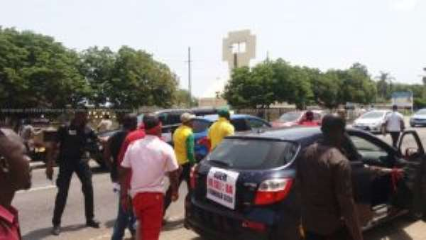 Seven Groups Demonstrate Against Luxury Vehicle Tax
