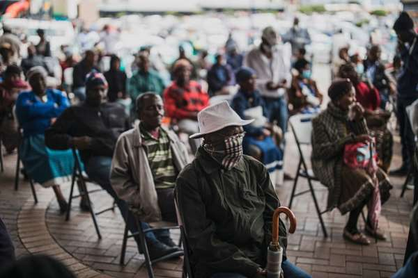 An elderly man at a social grant paypoint in South Africa after the COVID-19 lockdown.  (Photo by MARCO LONGARI / AFP) () - Source: Photo by Marco Longari/AFP via Getty Images
