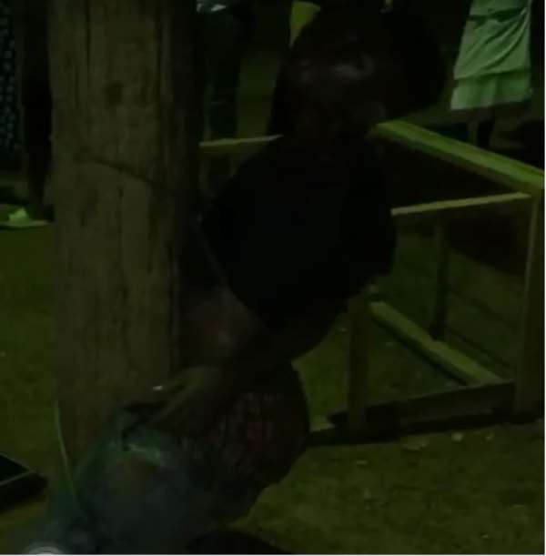 The suspect tied to an electricity pole