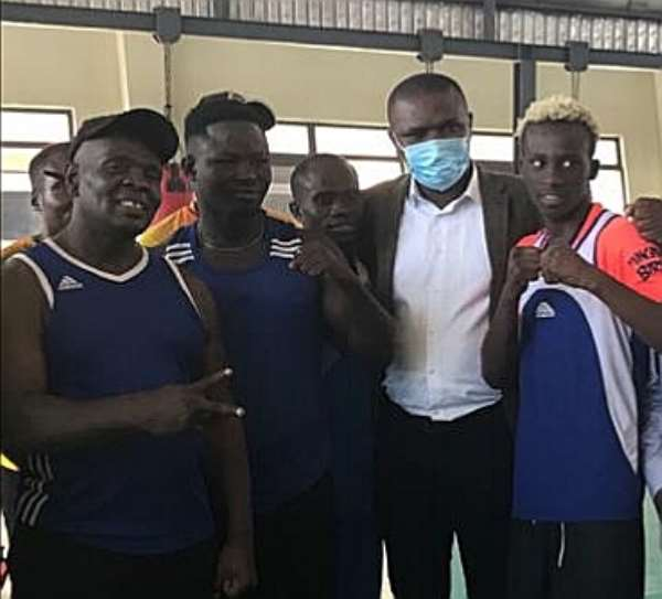 Sports Minister Mustapha Ussif donates US$1,000 to Black Bombers at historic visit to training camp
