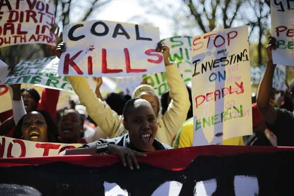 Demonstrators in Johannesburg march against environmental damage done by coal. - Source: Photo by Cornell Tukiri/Anadolu Agency/Getty Images