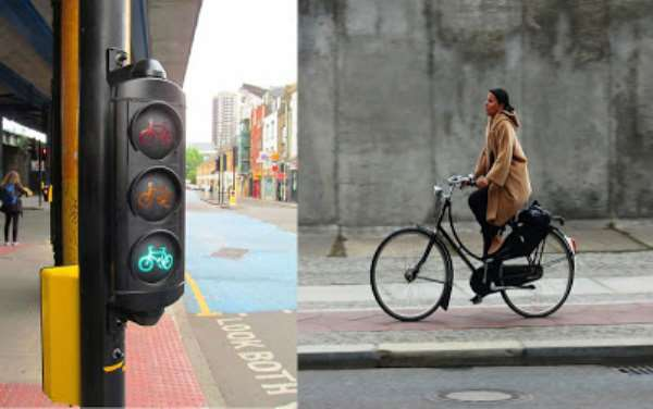A lady on her way to work under a bicycle traffic light regulation to secure her safety. Which part of Ghana can cyclists traffic light be found?